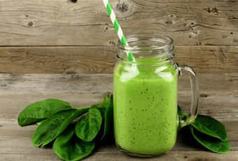 Healthy Green Smoothie With Spinach In A Jar Mug On Wood