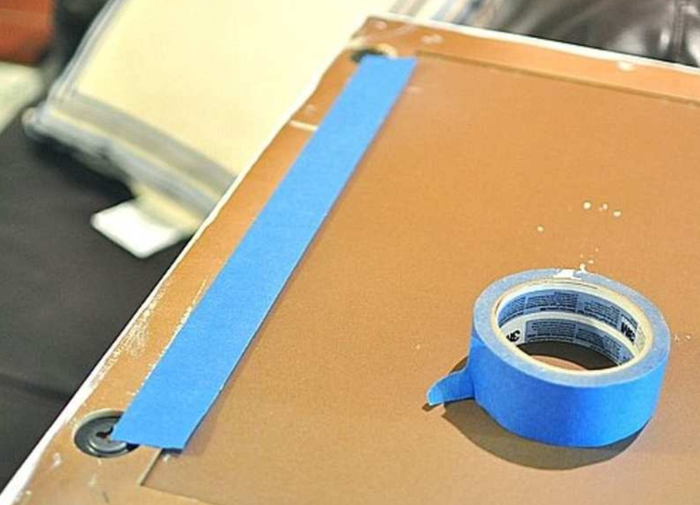 31. Hang Frames Easily With Tape
